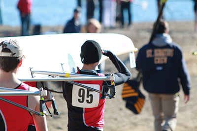 Carrying boat to launch at the Blake Haxton Regatta