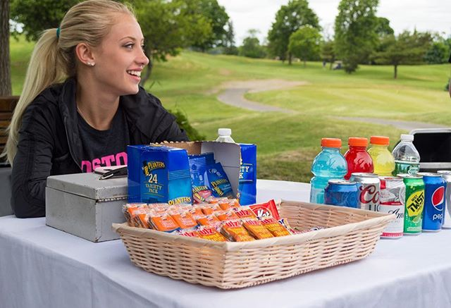 Hungry? 😋 Come grab a bite with Emma while you're out on the course at her famous snack stand!