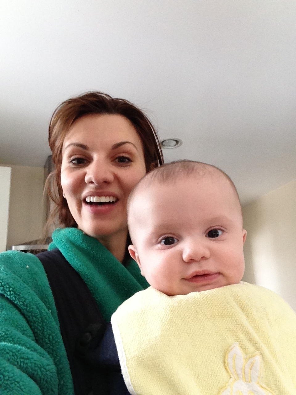 Green robe and  Baby Bjorn =my mom uniform during Greyson's first year.