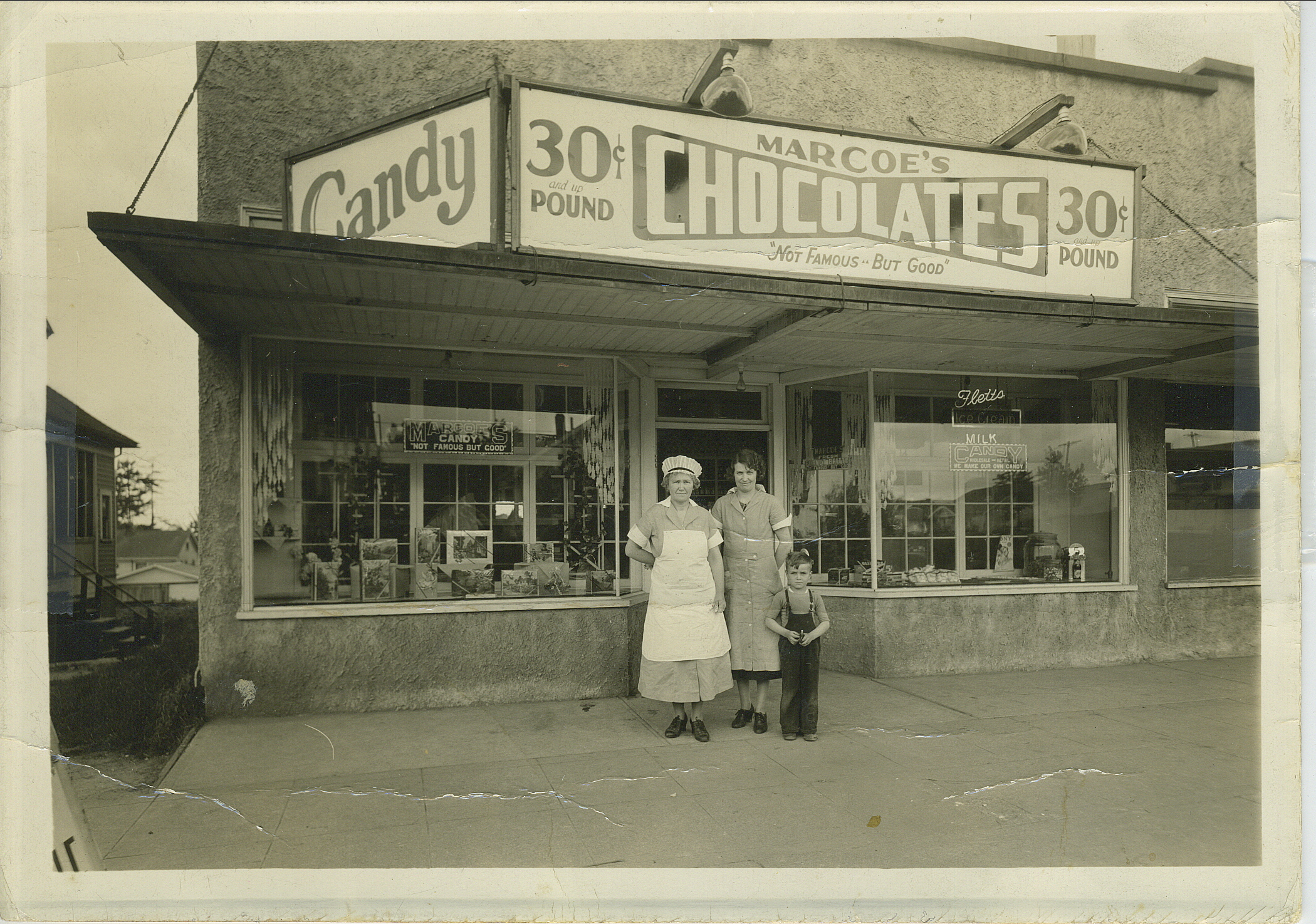 "Original Marcoe's Candy store & factory on South M street in Tacoma circa 1935. Dora Marcoe (center) with youngest son ""Bunky""."