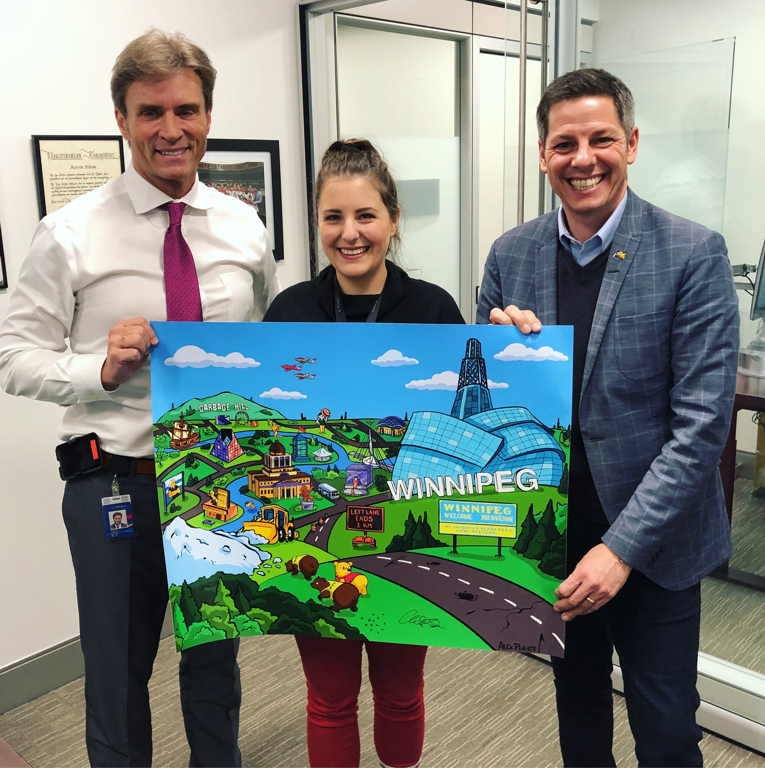 Holding a signed copy with Winnipeg's Mayor Brian Bowman and City Councillor Kevin Klein