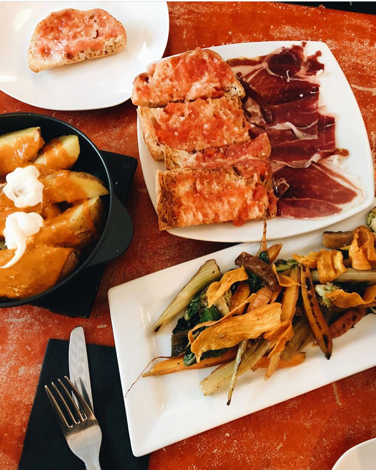 Tapas | Barcelona, Spain  Tapas translates to a small portion appetizer or snack. The must tries in Barcelona:  La Bomba  Papas bravas: potatoes with a special spicy aioli, quite similar to mayonnaise. It is traditionally made with garlic, olive oil, and salt.