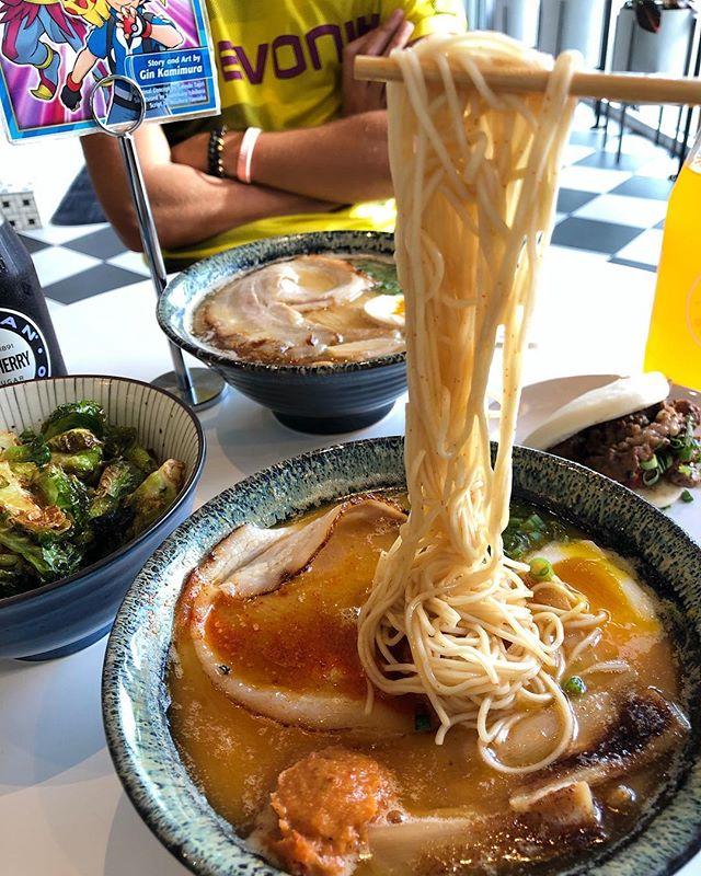 Kon'nichiwa send noods🍜😂 . . . Pictured: spicy tonkotsu, brussle sprouts, bulgogi steamed bun . . What is TONKOTSU ramen ? creamy pork bone broth, rolled sliced pork belly, shoyu tamago egg, bamboo shoots, scallions, black garlic sesame . . . #ramen #ramennoodles #noodlepull #ramenlover #ramengram #atleats #Atlantafoodie #Zipkick #zipkickinfluencer @ramenstationatl @zipkick @grantparkmarket