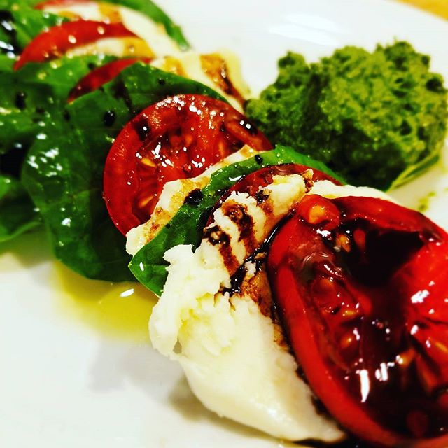 Tomato, basil, mozzarella with a little pesto drizzled with olive oil and balsamic. Sometimes simple is best.