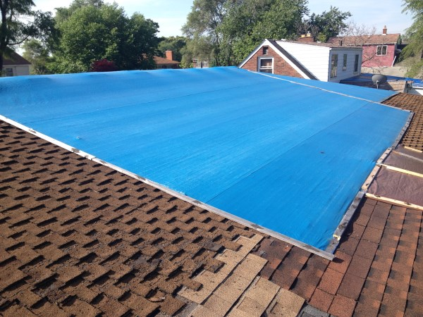 tarp on roof 2.jpg