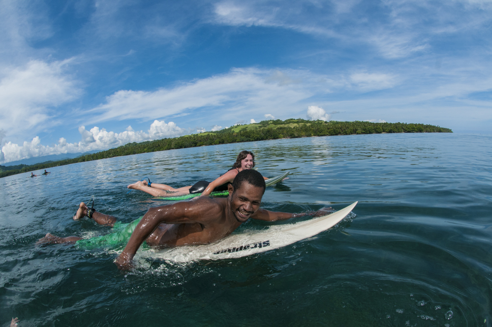 Angie and Jeberdi, paddling out for another round.