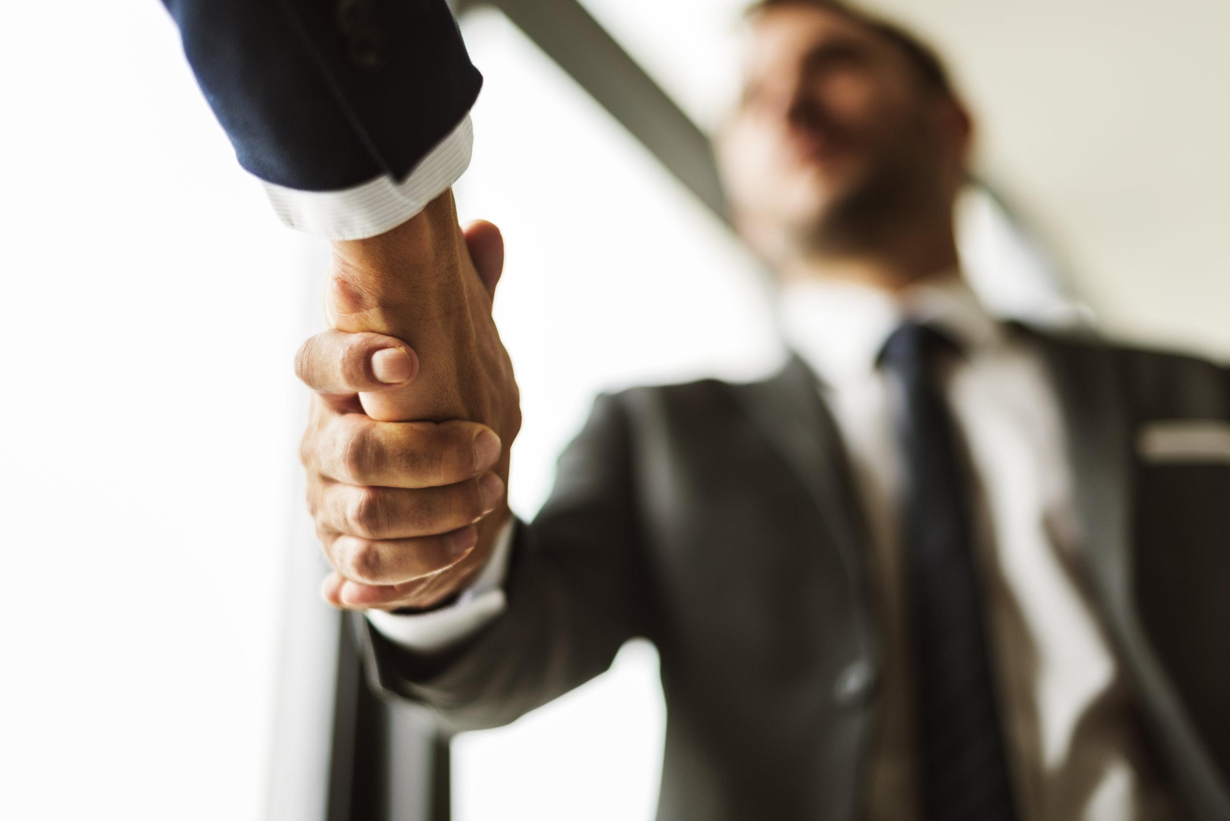 deal-businessmen-handshake-partnership-concept-PF3GLKS (1).jpg