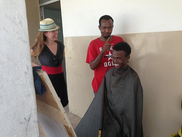 All of life is at a migrant camp, including a Somali barber.