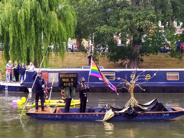 'Stonewall was a riot' banner at Cambridge Pride (UK) in June 2019: Remembering the shifting rights to 'ownership' of spaces such as Stonewall Inn (the New York gay bar, the police raids of which led to the opposition from queer community in 1969 and to the first ever Pride marches), as well as 'ownership of oneself' particularly stark in case of activists of colour given the lack of freedom their communities have suffered. (Photographed by Marcin Smietana)