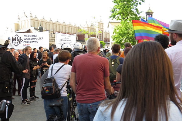 The rainbow Equality March in Kraków, Poland, meets a far-right counter-protest whose main banners say 'All Poland's Youth against LGBT' and 'Normality has died'. May 2019.