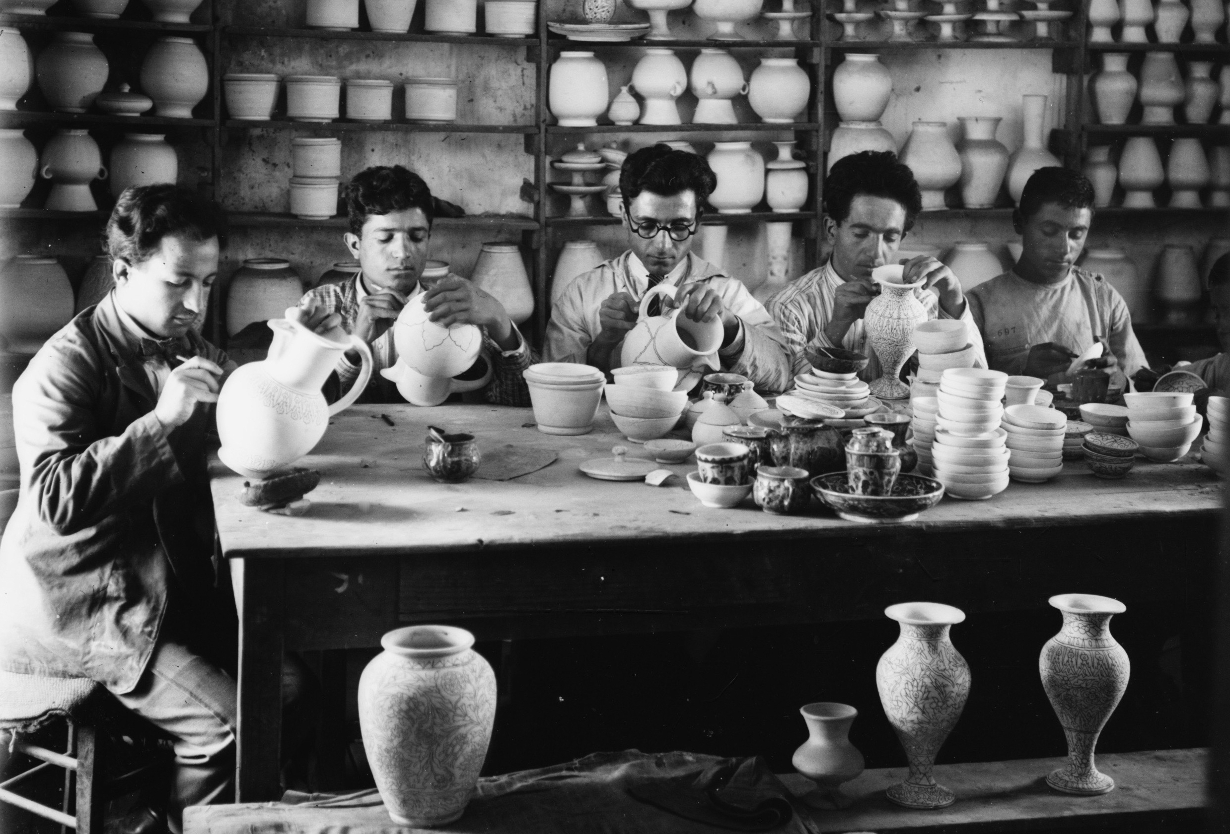 Young men drawing designs on pottery, c. 1922. (Library of Congress, Matson Collection)