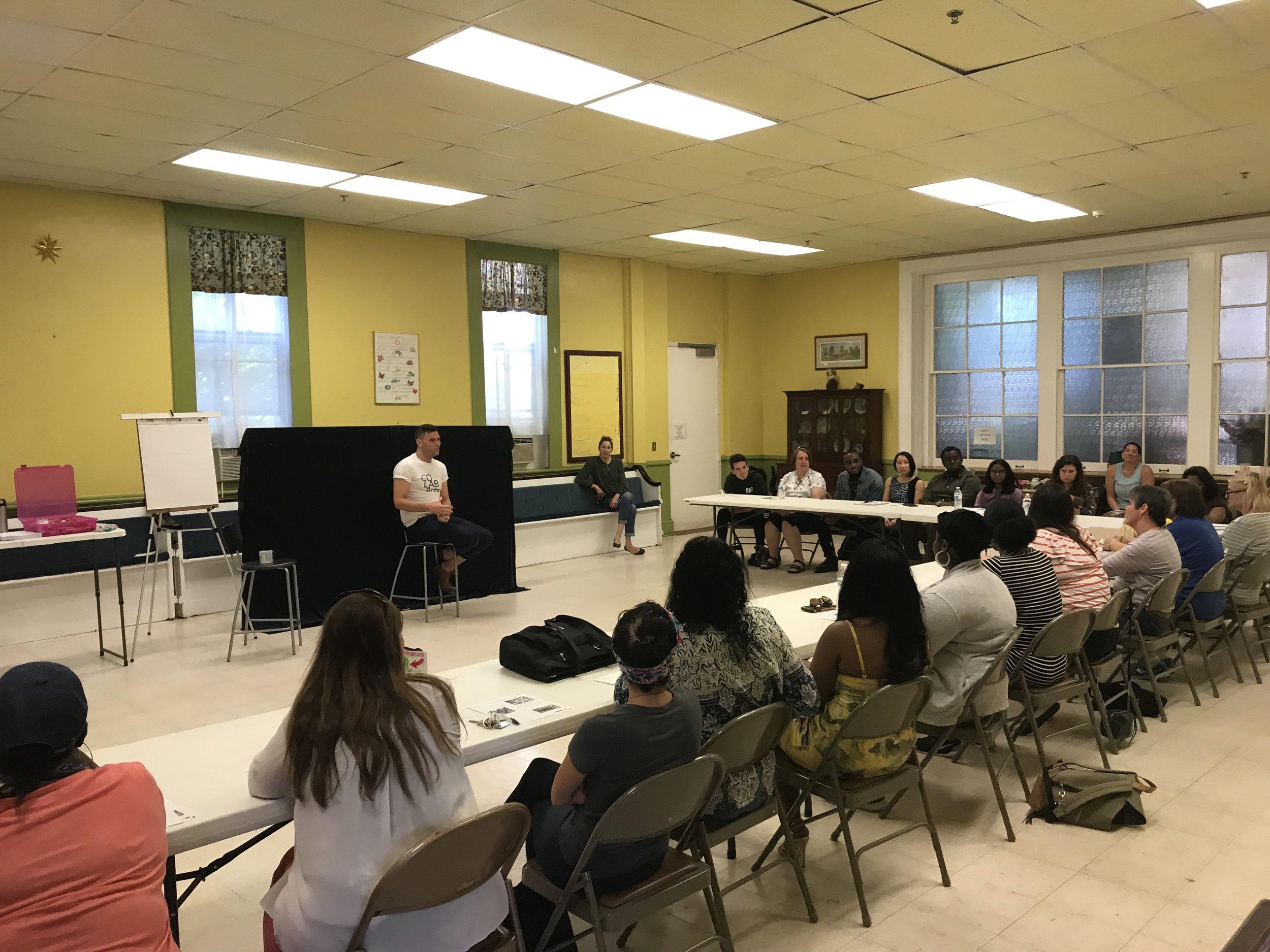 Lead teaching artist Dustin Ballard conducting a community workshop.