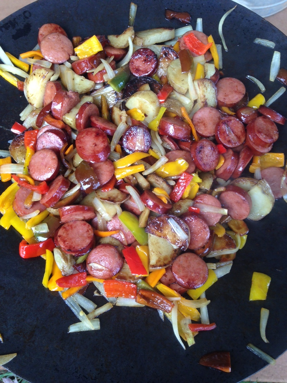 Kielbasa, potatoes, onions, and bell peppers.