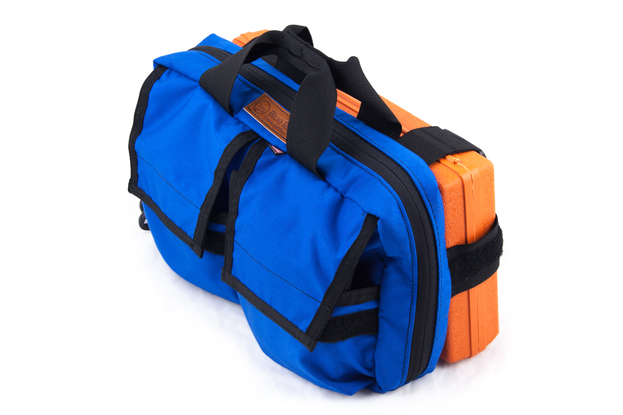 """The outer harness will fit around and secure the repair kit or adjust to any kit box that is around 14""""L x 7""""W."""