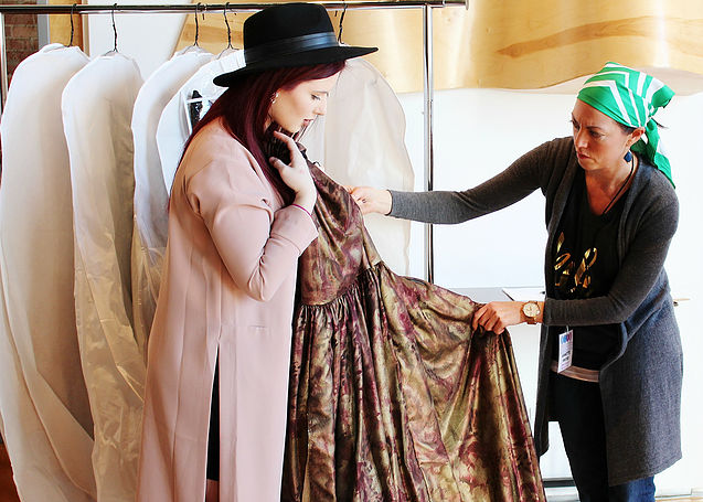 Designer Kiana Godsey shows her collection during rack check to Director of Production,   Annette Pinter   .