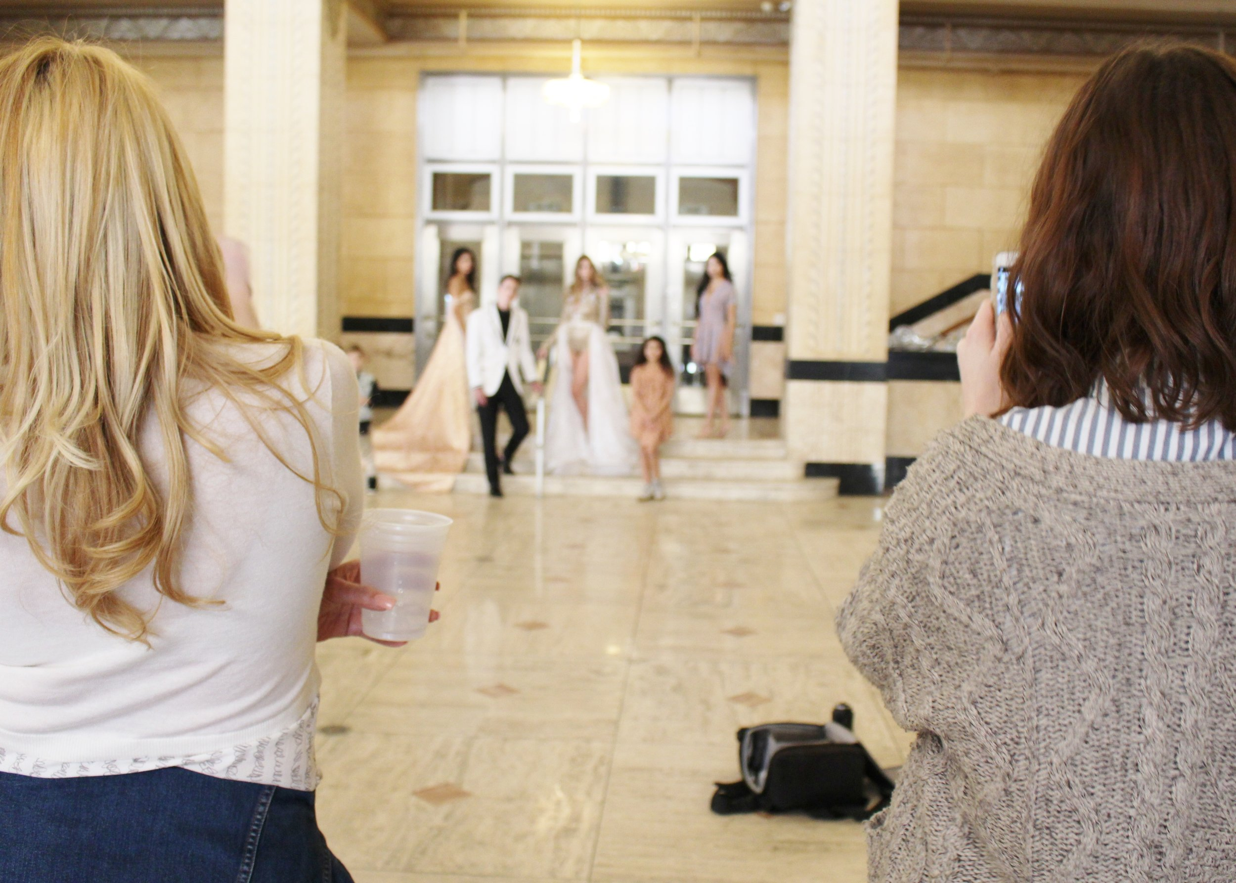 Designers  Georgina Herrera and Meghann Wheelock watch from behind the scenes.