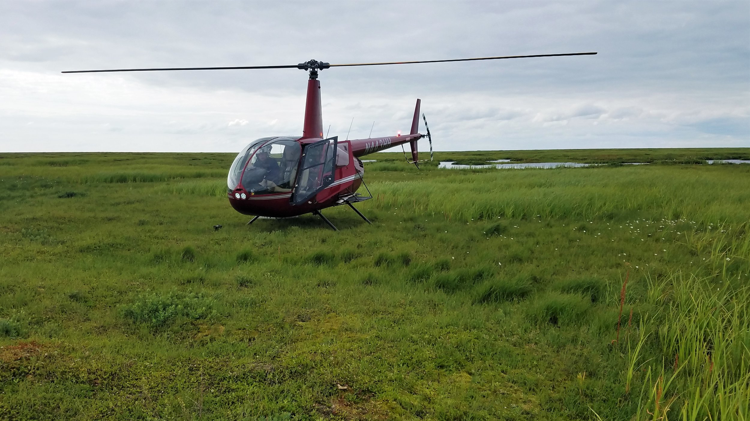 R44 Helicopter on the intertidal area near the Kuskokwim River Delta.