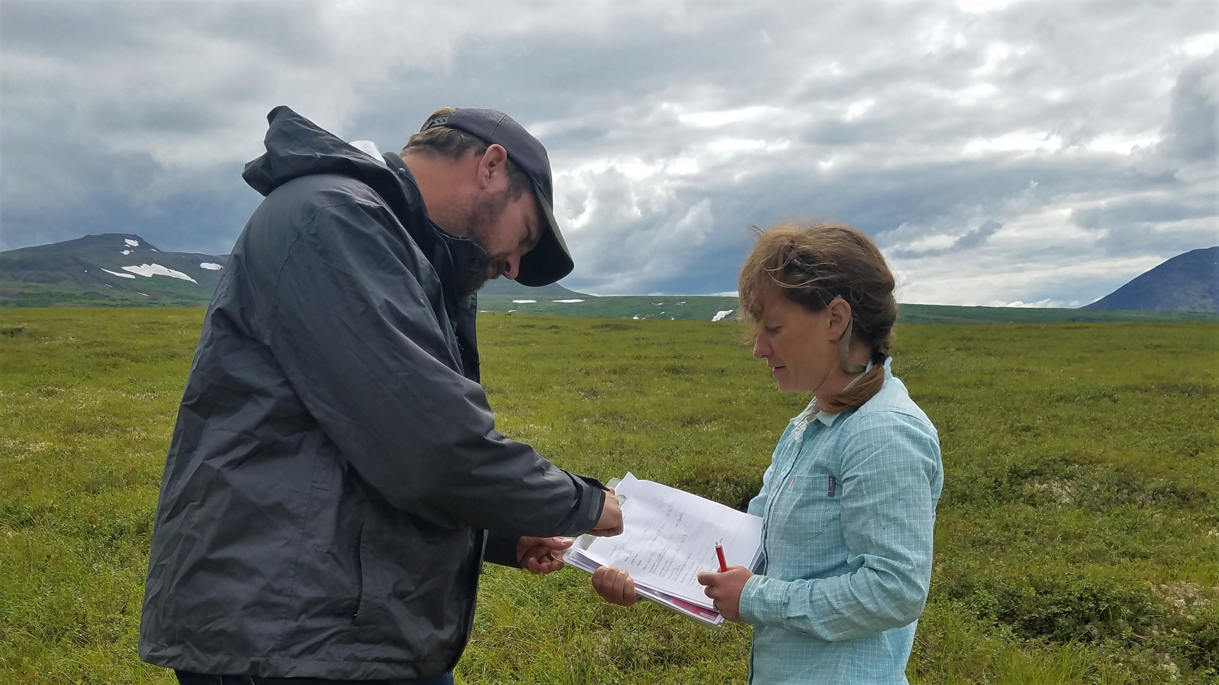 Kevin Stark (Saint Mary's University of Minnesota) and Elizabeth Powers (U.S. Fish and Wildlife Service - Alaska) discussing field indicators for wetlands.  Photo Credit: Andy Robertson