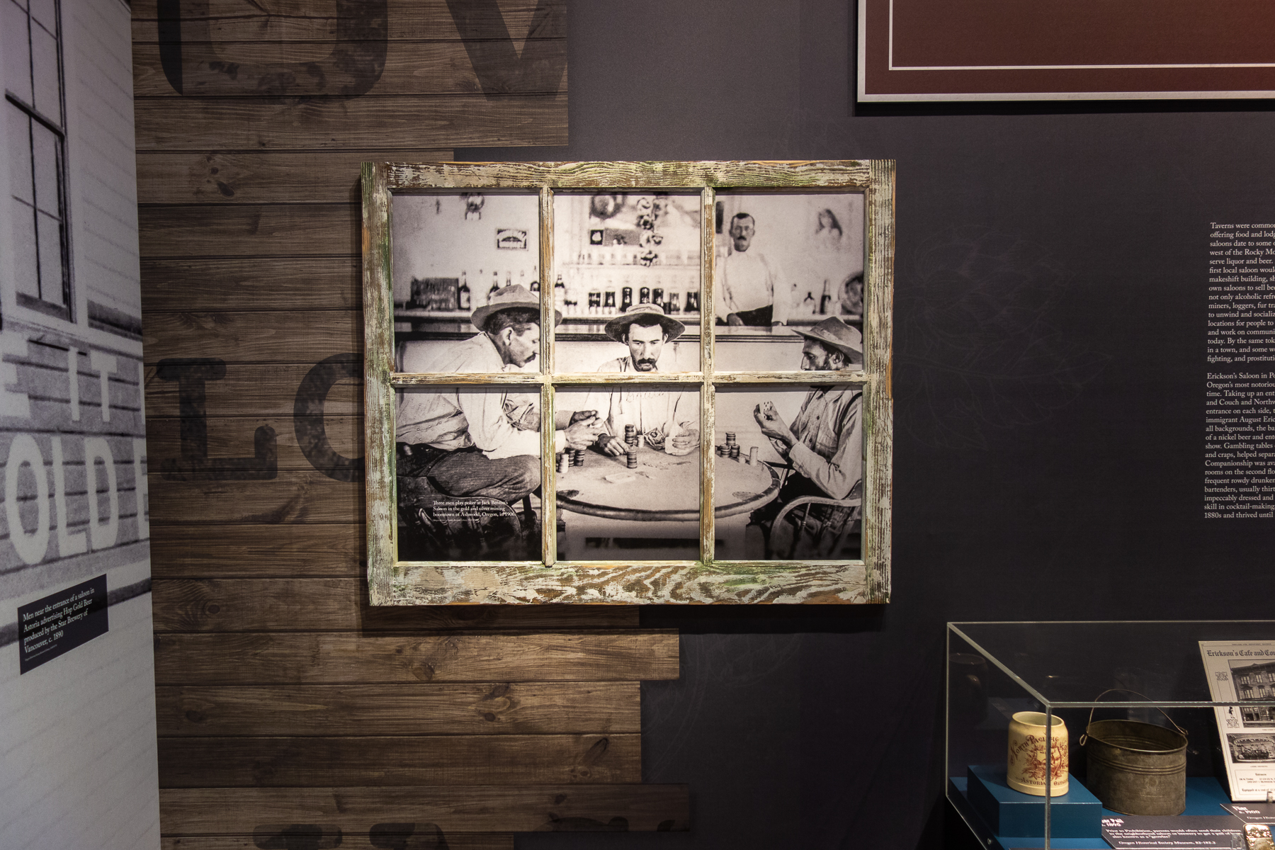 Our shop custom built these weathered windows with historical images of scenes inside of a saloon back mounted to them.