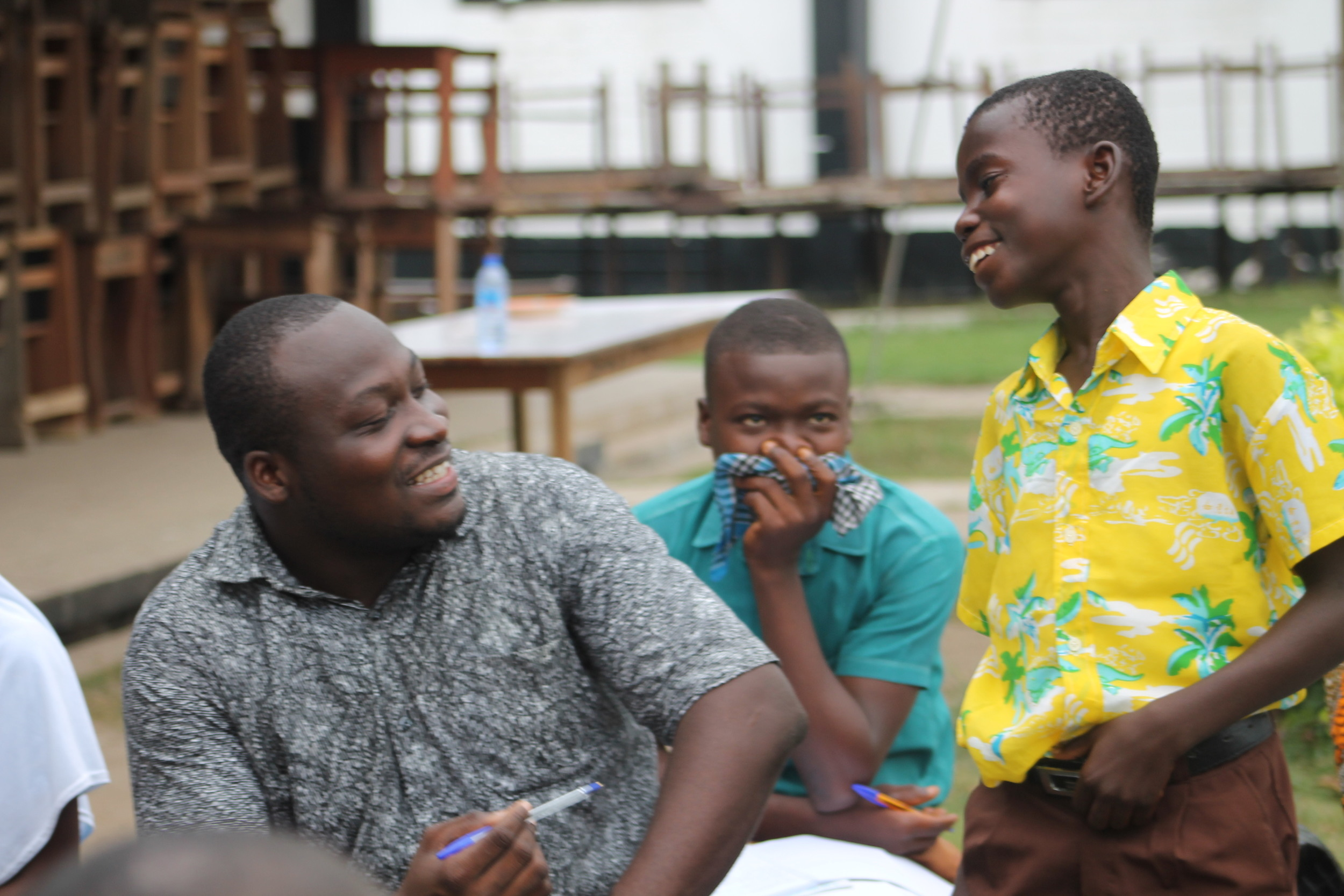 Foster Adzraku, from the Ministry of Gender, shares a laugh with students during one of the interactive sessions.  Photo by Stephanie Gasana