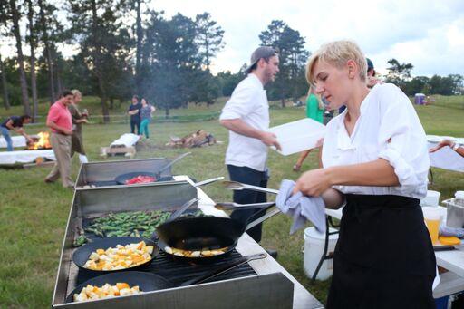 staff preparing summer squash on grill.jpeg