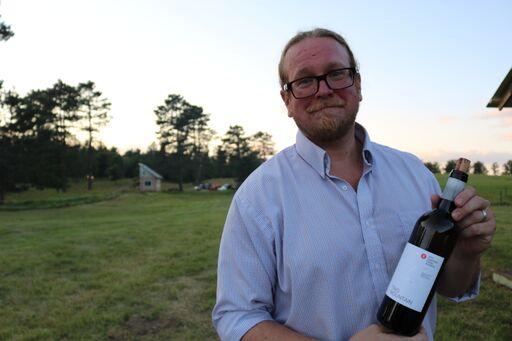 Derek with bottle of wine.jpeg