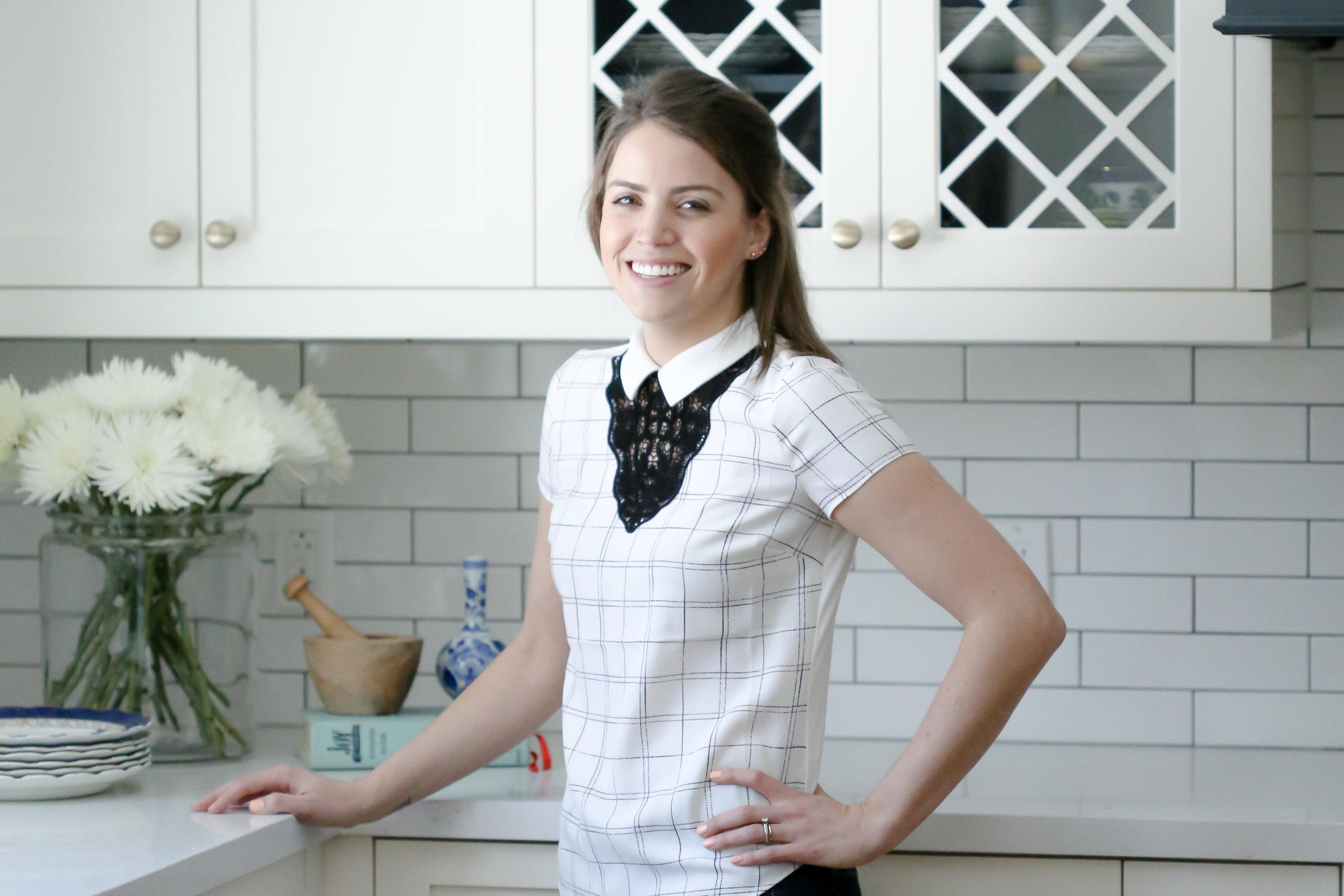 Senior Designer Kristi Lee Robb in the Burnside Cottage kitchen renovation. Courtesy of Kelly Tomlinson Photography.