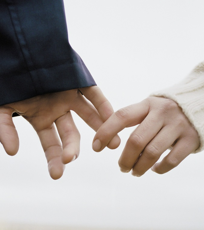couple close up hands separating medium size crop.jpg