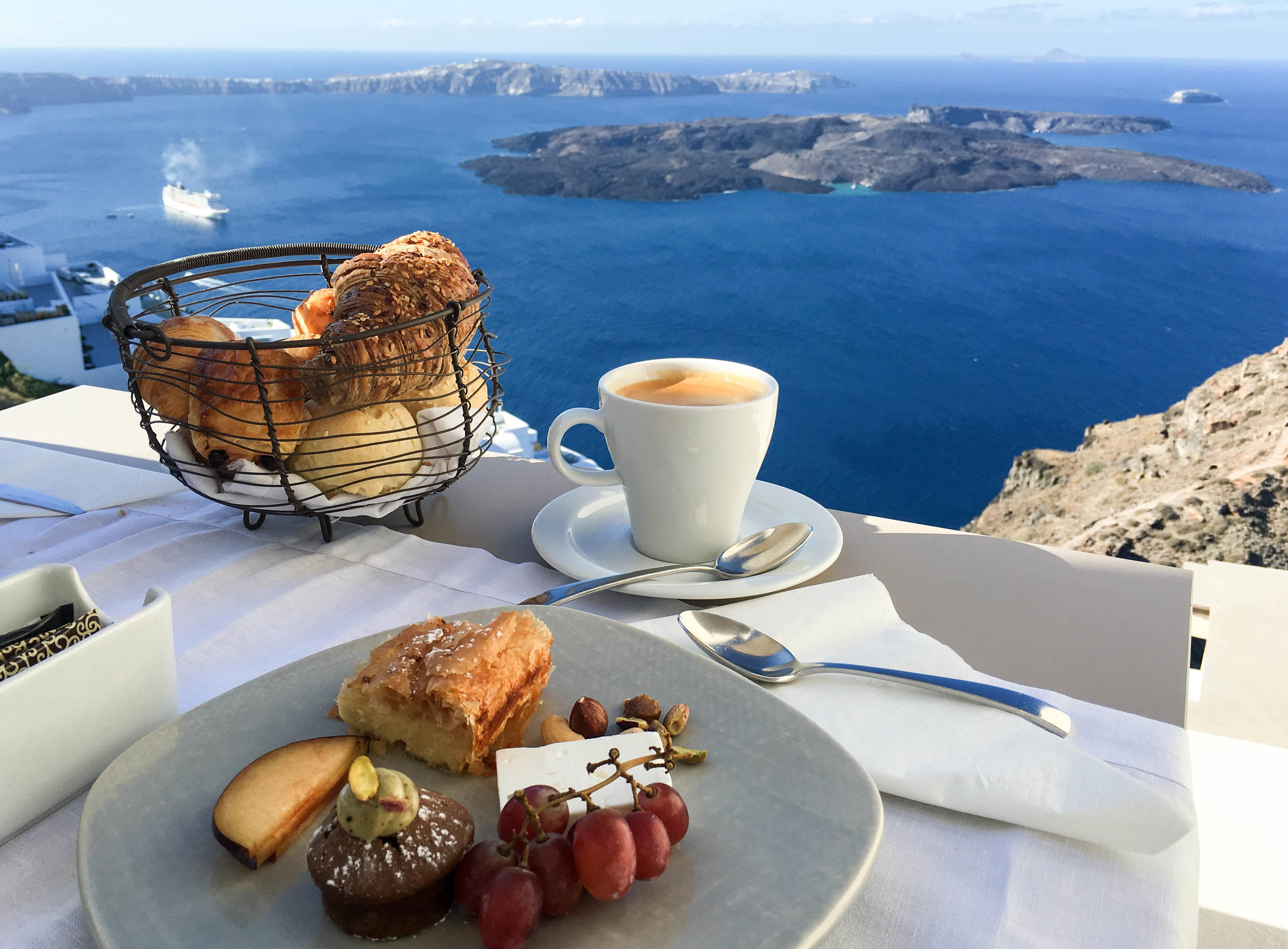 Breakfast with a view at Kapari Natural Resort, Santorini, Greece (note the aforementioned seeded croissant!)
