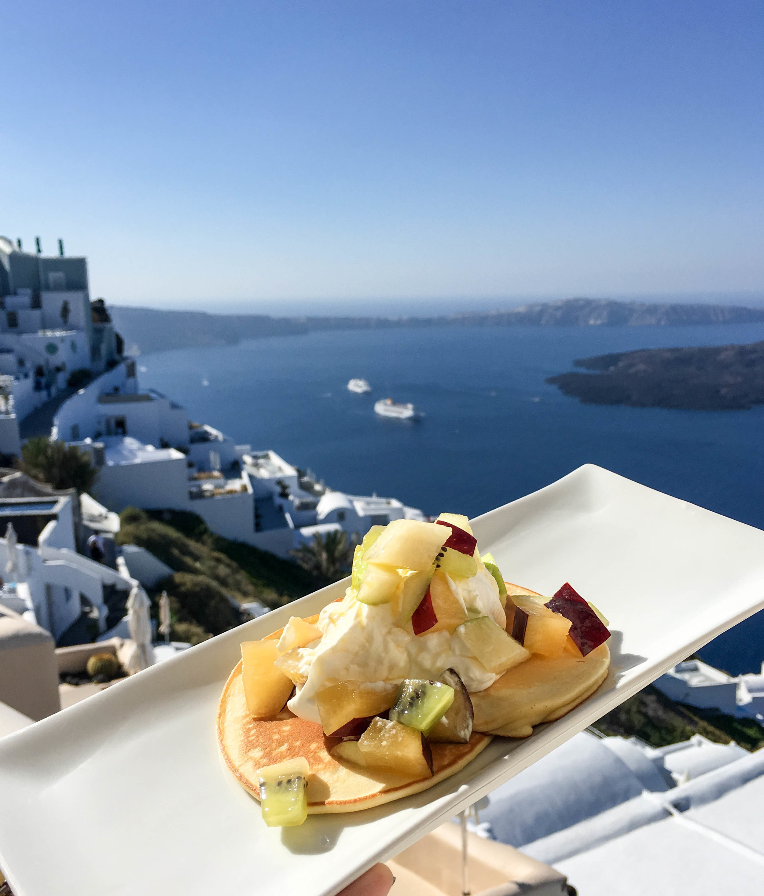 Pancakes with fruit and yogurt at Kapari Natural Resort, Santorini, Greece