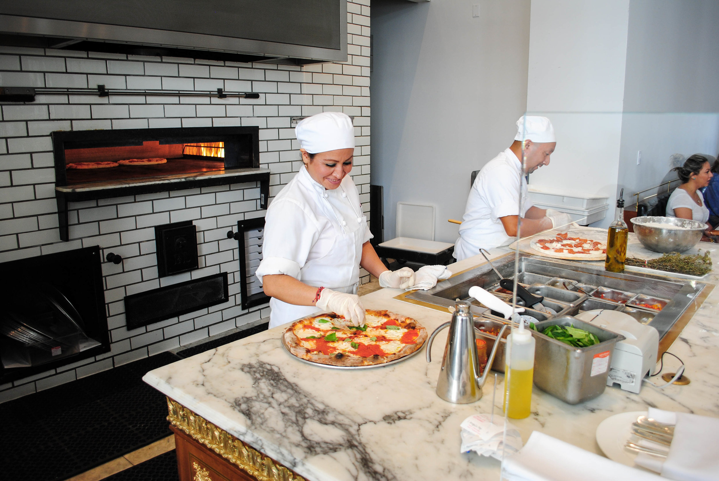 The masters at work at the pizza oven, Bottega Louie, Downtown Los Angeles, CA