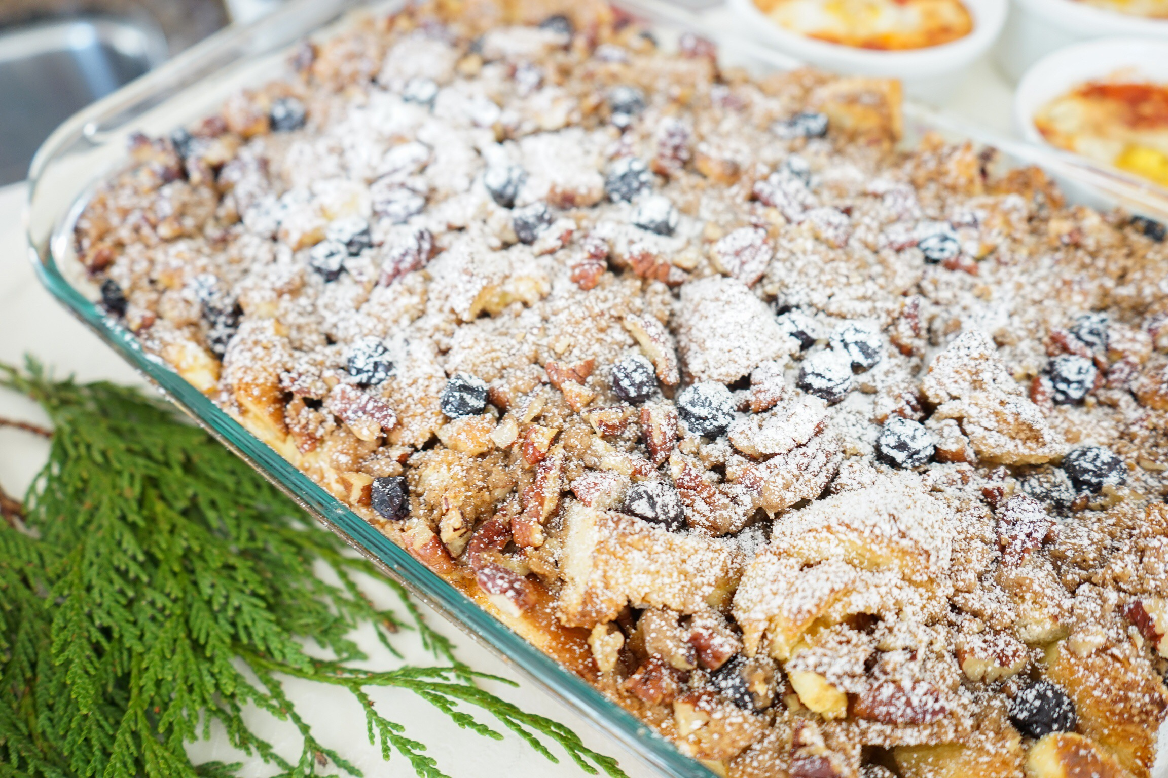 Blueberry Cream Cheese Overnight French Toast with a pecan streusel topping