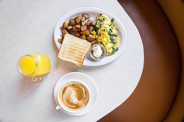 Getting cozy in the corner booth for brunch 🥰 📍@thewafflela | Hollywood, CA 🍳Florentine scramble, orange juice, and latte 👍🏼We loved how this casual diner still felt modern and cool with its Hollywood retro vibe. Such a fun spot for brunch in Hollywood! . . . #thewafflela #waffle #hollywood #brunch #breakfast #denverscramble #latteart  #infatuation #eaterla #zagat #eeeeeats #feedfeed #forkyeah #laeats #buzzfeast #lafoodie #latimesfood #losangeles #foodstagram #instafood #foodphotography