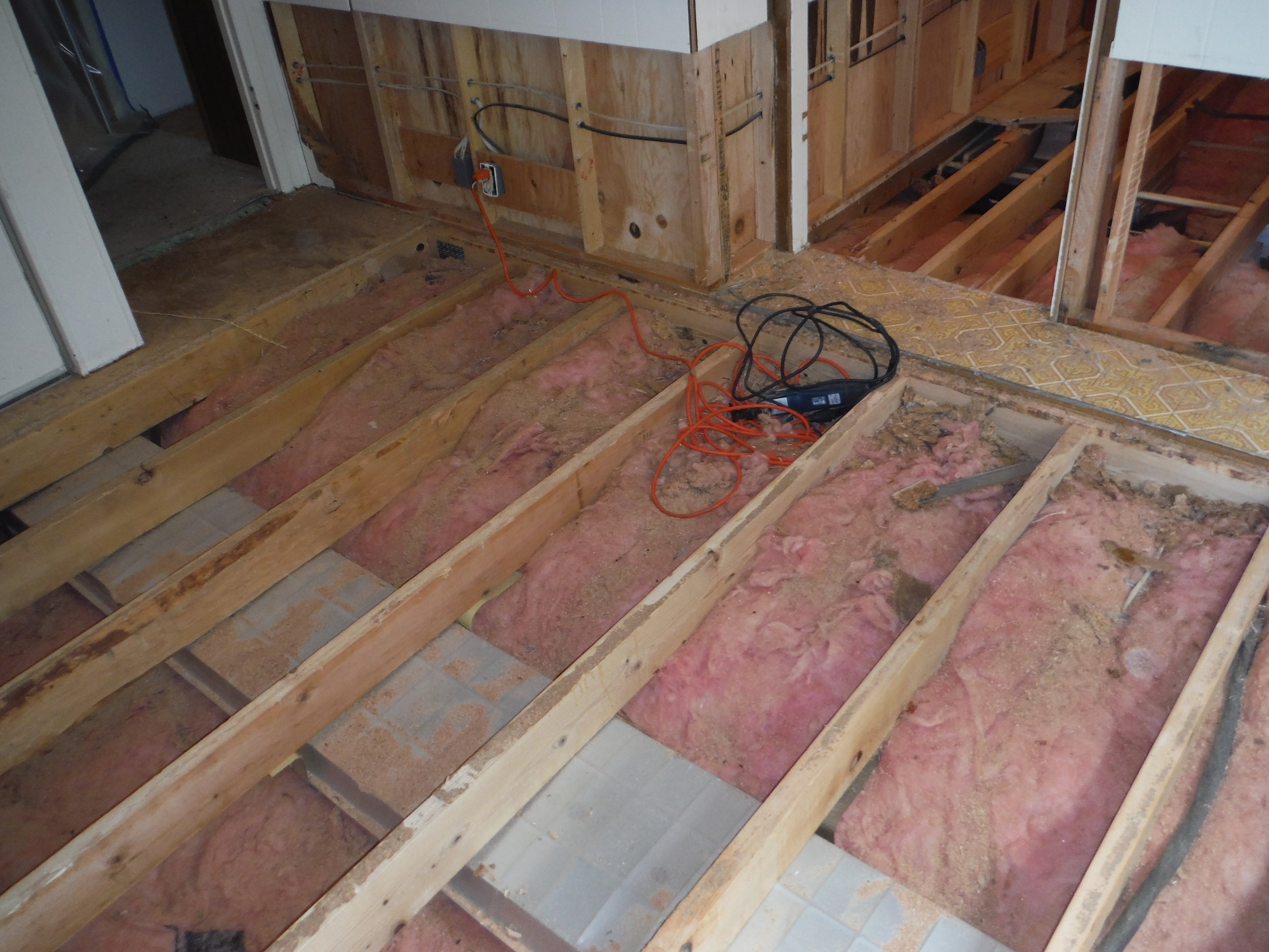Removal of damaged subfloor and wet insulation