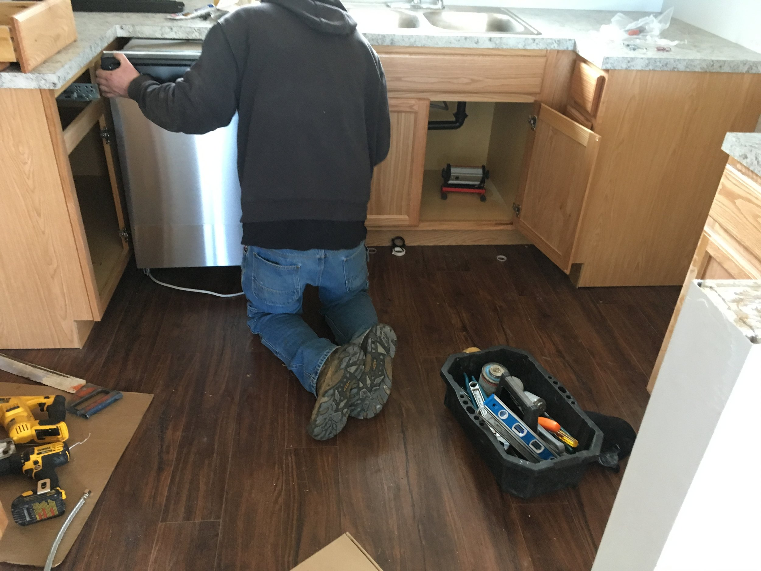 Our Plumber setting new stainless steel appliances.