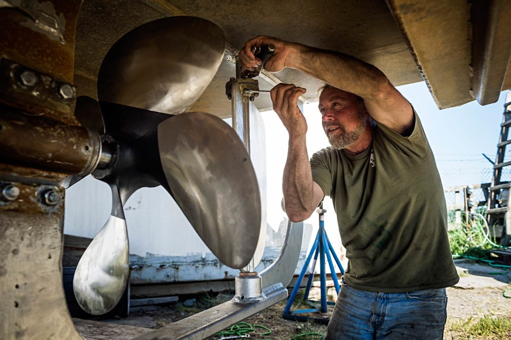 Mid-June is a scramble as some 1,650 fishermen and their crews ready for launch. Here, Corey Potter, of Vermont, tightens the last couple bolts on his rudder after replacing his prop on the F/V Melody.