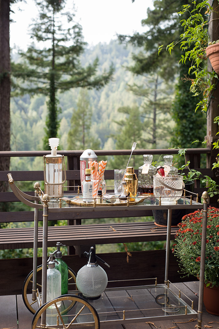 Even though I live in the woods, I love a little vintage glam. Sometimes I wish I would have been around in the late 1940s or early 1950s- I love the whole aesthetic of that time. I found this bar cart in an antique store in Santa Rosa, CA, a few years ago and it's fun to pull outdoors for parties so guests can mix their own drinks. Most of what adorns it has been collected over the years at rummage sales and antique stores, but the cocktail basics (like the gold shaker, mixing glass and bar spoon) are all from  Umami Mart  in Oakland.  The San Francisco Chronicle did a piece last weekend in the Sunday paper showing 5 different designers' bar cart set-ups (including mine!) in preparation for the holidays. I mention our favorite seasonal cocktails including  my favorite cold weather drink .  Check out the article  by Anh-Minh Le- it's a fun read.  Cheers!