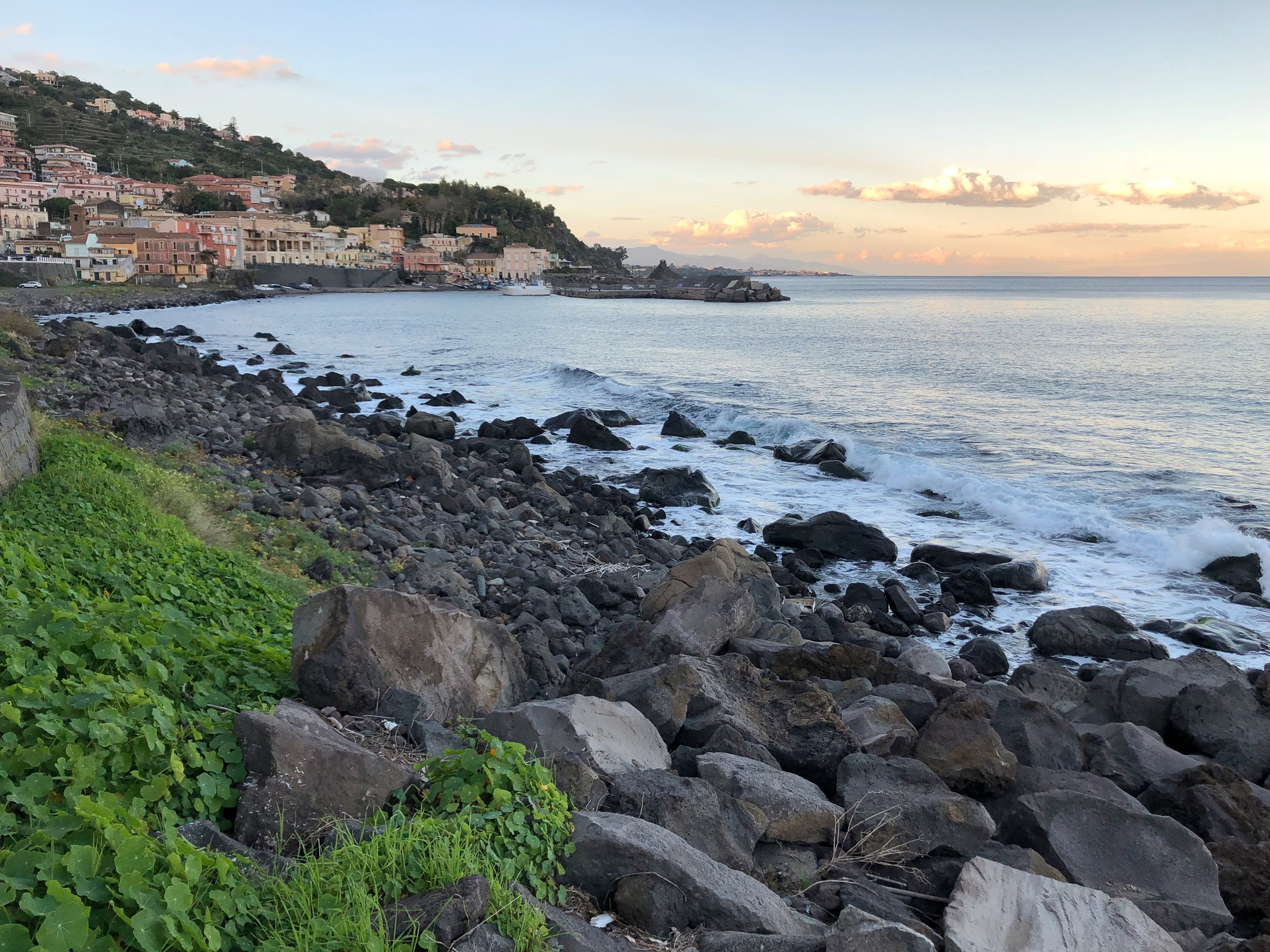 After going to the top of Mt. Etna, our day ended here, with a sunset walk on the water in Santa Maria La Scala (near Acireale).