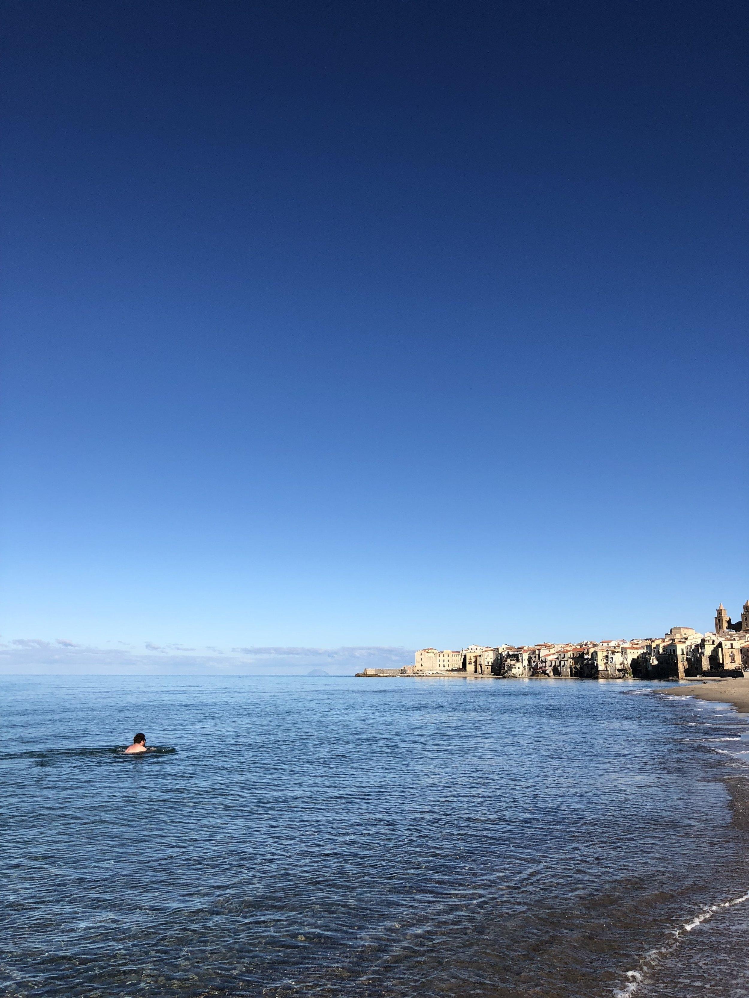 Jon swimming in Cefalu.