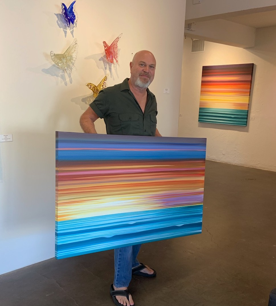 "Clovis with his work, ""The Bright Side"""