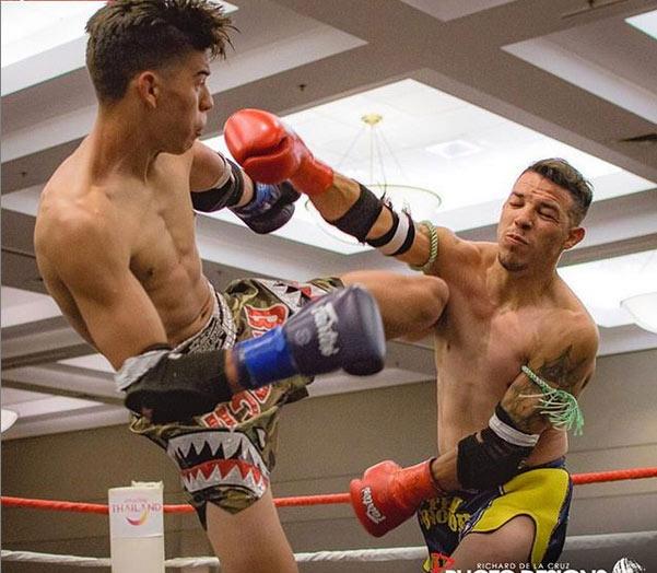 lorenzo kicking muay thai champion trainer.jpg
