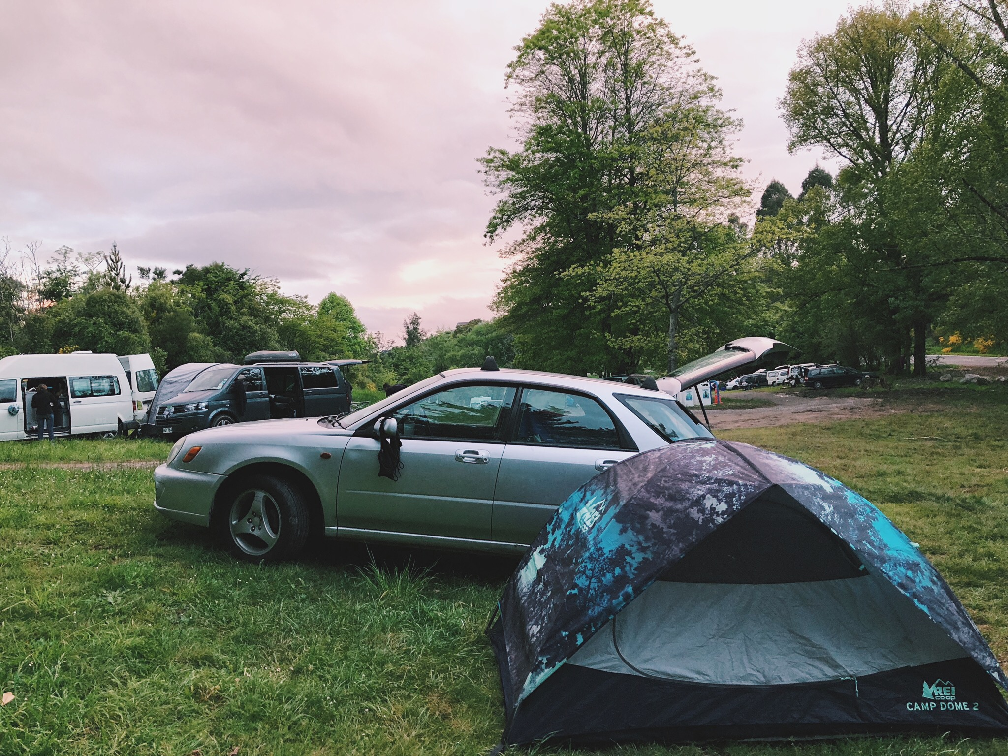 """Beezy and the tent at """"Camp 15-Degree-Tilt."""" Pro tip: wing mirrors are a great place to dry swimsuits."""