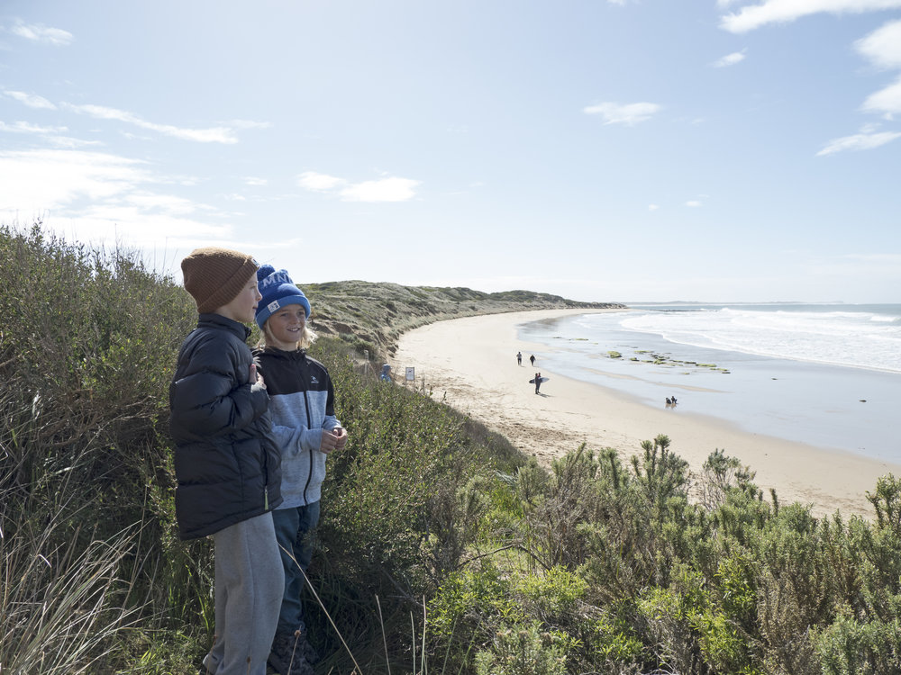 Groms having a yarn about the surf at 13th Beach, Victoria. Pic credit: thirteenthbeachboardriders.com