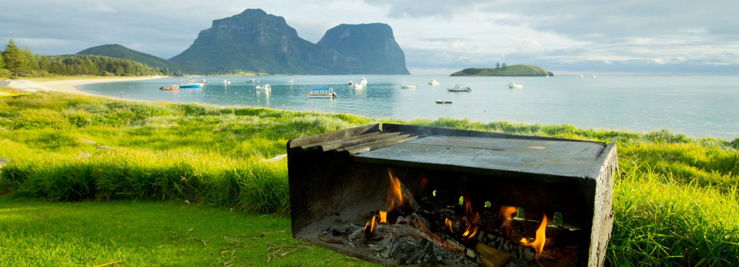 Lord Howe's 11 beautiful beaches are perfectly suited to barbequing outdoors, with their golden sand and spectacular views of the island. Pic credit: luxurylodgesofaustralia.com.au