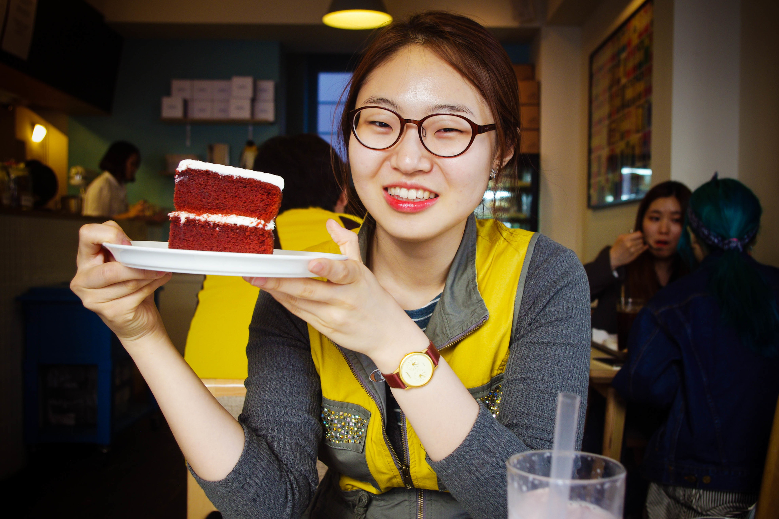 Juhong with the beautiful slice of cake.
