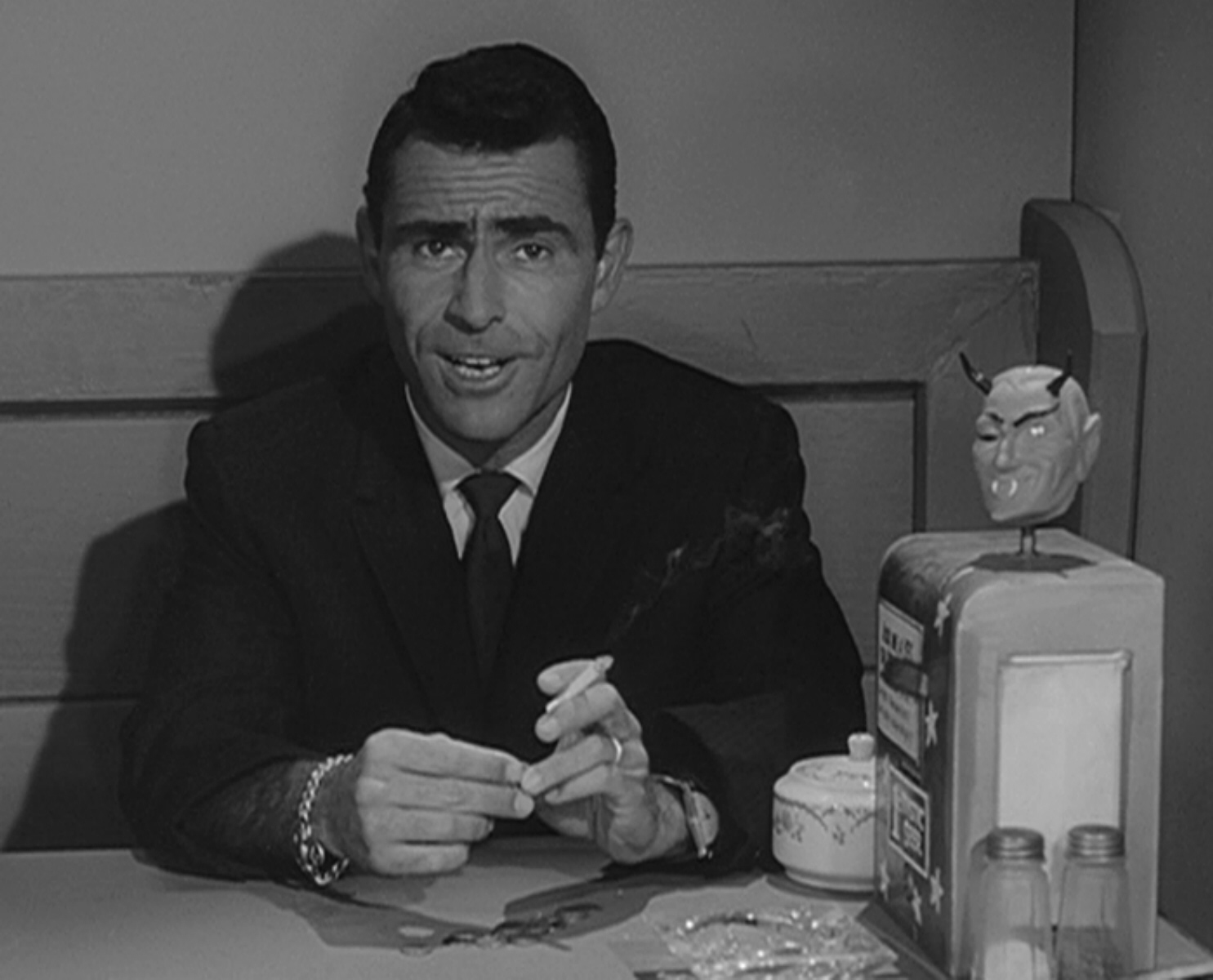 "Rod Serling introducing 'The Twilight Zone' episode ""The Nick of Time,"" starring William Shatner and Patricia Bresling."