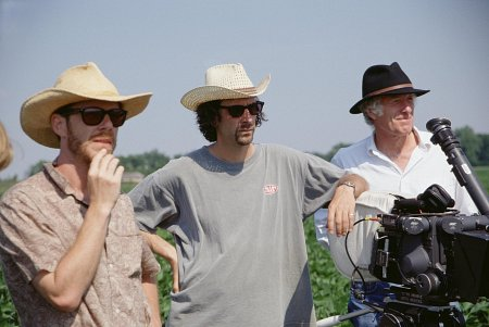 Roger Deakins (right) and the Coen Brothers. Image via Collider.