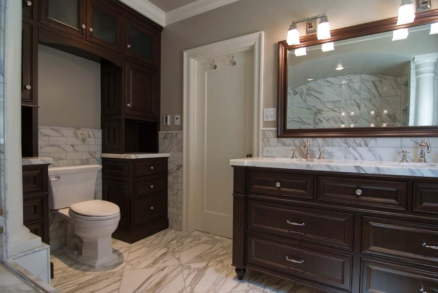 Stained walnut and marble bathroom