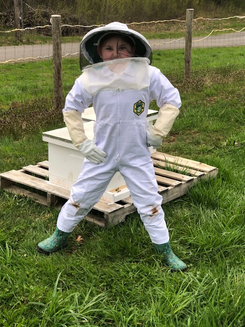 Jacquei helping dad with the bee's