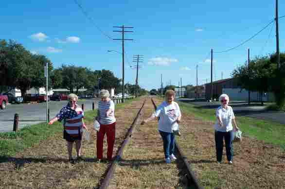 Seeding the railroad tracks with bluebonnets.jpg